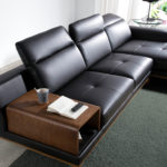Sofa with chaise longue upholstered in PVC and walnut wood legs