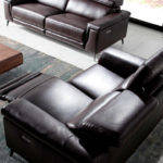 2-seat sofa upholstered in leather with 2 x electric relax mechanisms and stainless steel legs