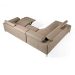 Corner sofa upholstered in leather and stainless steel legs