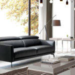 3-seat sofa upholstered in leather with stainless steel legs