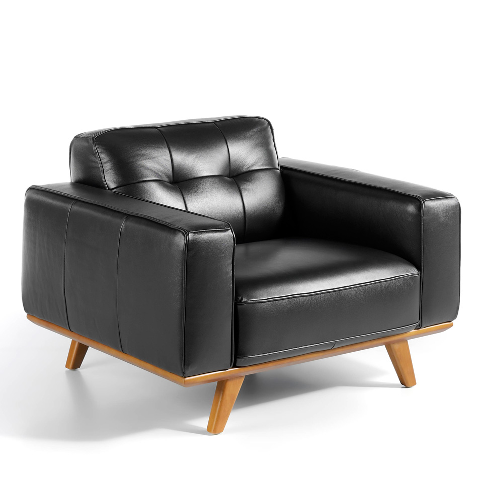 Leather upholstered Armchair with solid walnut legs