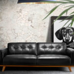 2 seat leather upholstered sofa with solid walnut legs