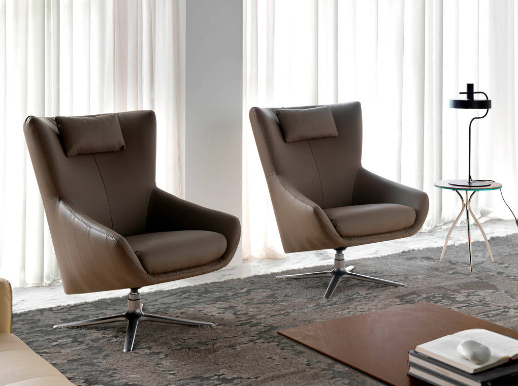 Upholstered in leather armchair with stainless steel frame