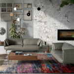 2 seat sofa leather upholstered with polished steel legs