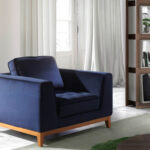 Armchair with legs in solid wood upholstered in velvet effect fabric