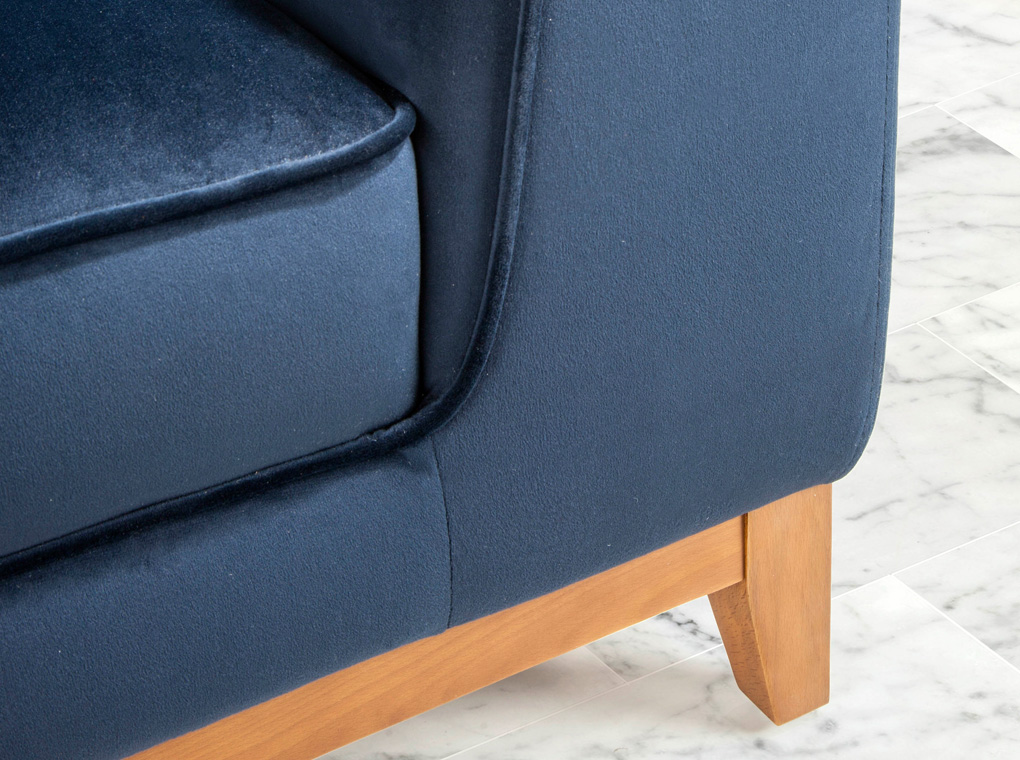 2 seat sofa with wood legs upholstered in velvet effect fabric
