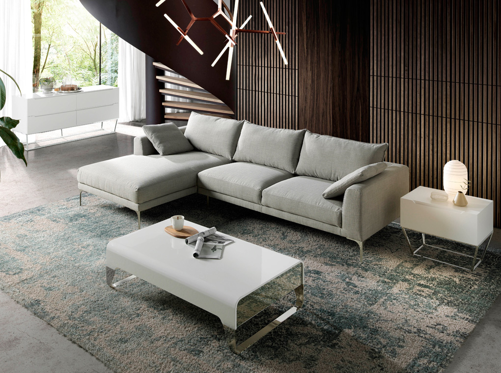 Sofa with chaise longue upholstered in fabric