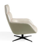 Swivel armchair upholstered in leatherette