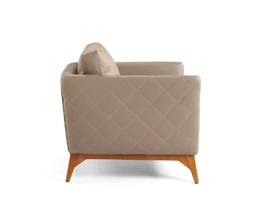Armchair upholstered in leather with walnut wood legs